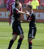 D.C. United defender Jared Jeffrey, left, celebrates his goal with midfielder Colin Martin during the first half of an MLS soccer game against Toronto FC in Toronto on Saturday June 28, 2013. (AP Photo/The Canadian Press, Frank Gunn)