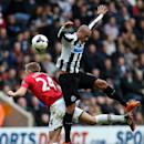 Manchester United's Darren Fletcher, left, in action with Newcastle United's Yoan Gouffran, right, during their English Premier League soccer match at St James' Park, Newcastle, England, Saturday, April 5, 2014