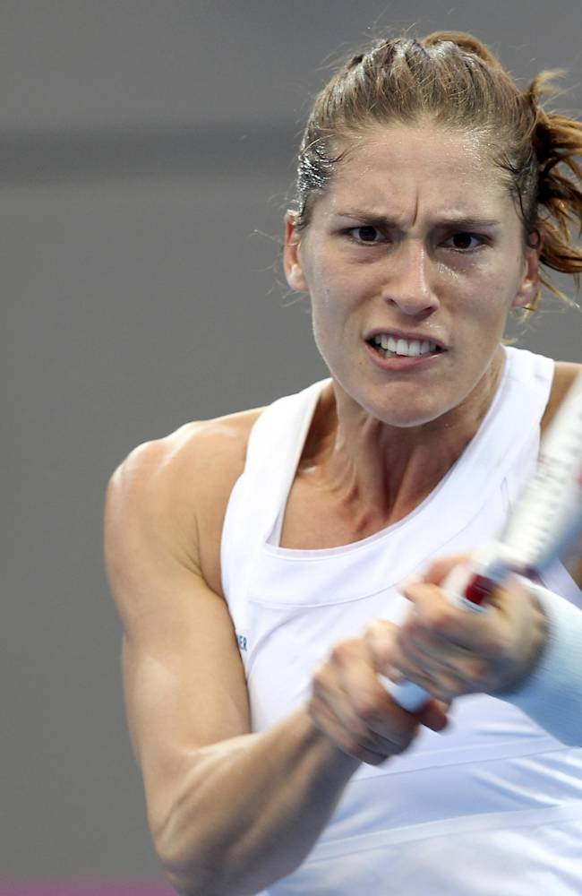 Andrea Petkovic of Germany plays a shot during her match against Samantha Stosur of Australia during the Fed Cup semifinals between Australia and Germany in Brisbane, Australia, Saturday, April 19, 2014