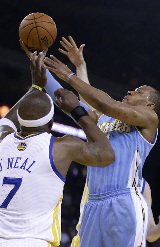 Denver Nuggets' Randy Foye, right, shoots over Golden State Warriors' Jermaine O'Neal (7) during the first half of an NBA basketball game Thursday, April 10, 2014, in Oakland, Calif