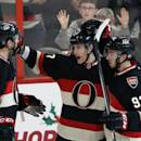 Ottawa Senators Kyle Turris, center, celebrates his third period goal with teammates Jared Cowan (2) and Mika Zibannejad (93) during an NHL hockey game against the Philadelphia Flyers on Monday, Dec. 9, 2013. in Ottawa, Ontario. (AP Photo/The Canadian Press, Fred Chartrand)