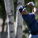 Matt Kuchar watches his tee shot on the second hole during the final round of the Humana Challenge golf tournament on the Palmer Private course at PGA West on Sunday, Jan. 25, 2015 in La Quinta, Calif. (AP Photo/Chris Carlson)