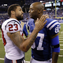 Houston Texans running back Arian Foster, left, greets Indianapolis Colts wide receiver Reggie Wayne following a 17-10 win by the Colts in an NFL football game in Indianapolis, Sunday, Dec. 14, 2014 The Associated Press