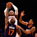 NEW YORK, NY - DECEMBER 20: Carmelo Anthony #7 of the New York Knicks attempts a shot over P.J. Tucker #17 and Gerald Green #14 of the Phoenix Suns in the second half at Madison Square Garden on December 20, 2014 in New York City. (Photo by Alex Goodlett/Getty Images)