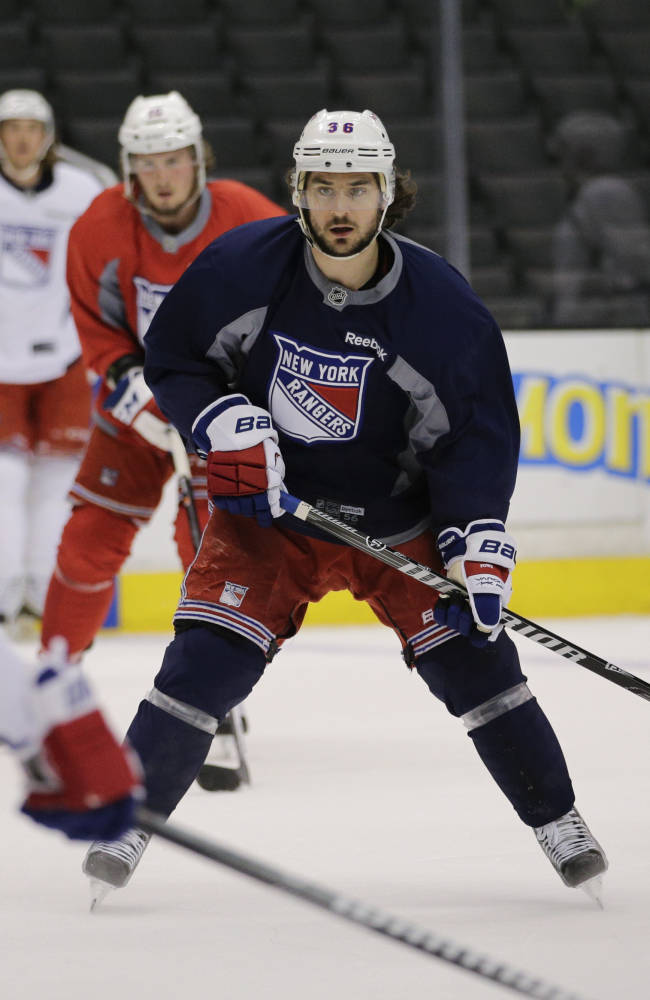 New York Rangers' Mats Zuccarello, center, of Norway, skates during practice for Wednesday's Game 1 of the NHL Stanley Cup Final hockey series against the Los Angeles Kings on Tuesday, June 3, 2014, in Los Angeles