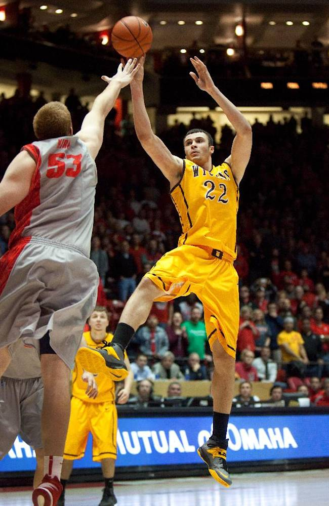 Wyoming's Larry Nance Jr. shoots over New Mexico's Alex Kirk in the second half of an NCAA college basketball game Wednesday, Feb. 5, 2014 in Albuquerque, N.M. New Mexico won in overtime 66-61