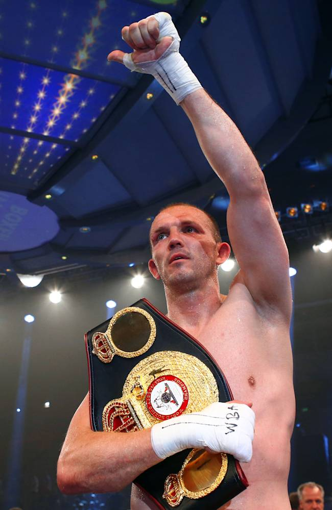 In this picture taken Saturday June 7, 2014, Germany's light heavyweight WBA world champion  Juergen Braehmer celebrates after winning his b title bout against  Roberto  Feliciano Bolonti of Argentina in Schwerin, eastern Germany.  Braehmer  unanimously outpointed Roberto Feliciano Bolonti of Argentina to retain his WBA light heavyweight belt on Saturday. The boxing judges scored it 118-109, 119-108, 119-108 in favor of the 35-year-old Braehmer, a former WBO champion, who was making his second defense of the title he won by beating American Marcus Oliveira in December
