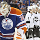 Los Angeles Kings' Justin Williams (14), Marian Gaborik (12) and Alec Martinez, right, celebrate a goal against Edmonton Oilers goalie Viktor Fasth (35) during first-period NHL hockey game action in Edmonton, Alberta, Thursday, April 10, 2014 The Associat