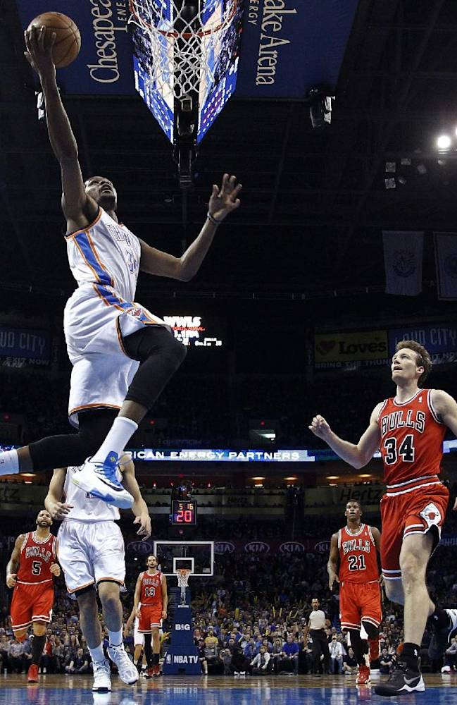Oklahoma City Thunder forward Kevin Durant (35) shoots in front of Chicago Bulls forward Mike Dunleavy (34) during the first quarter of an NBA basketball game in Oklahoma City, Thursday, Dec. 19, 2013