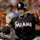 FILE - In this Aug. 25, 2014, file photo, Miami Marlins' Giancarlo Stanton celebrates his home run against the Los Angeles Angels during the fourth inning of a baseball game in Anaheim, Calif. A person familiar with the negotiations says Marlins slugger Giancarlo Stanton has agreed to terms with the team on a $325 million, 13-year contract. It's the most lucrative deal for an American athlete. The person spoke to The Associated Press on condition of anonymity because the Marlins hadn't confirmed the agreement Monday, Nov. 17, 2014.(AP Photo/Chris Carlson, File)