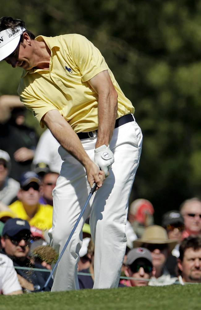 Gonzalo Fernandez-Castano, of Spain, tees off on the 12th hole during the first round of the Masters golf tournament Thursday, April 10, 2014, in Augusta, Ga
