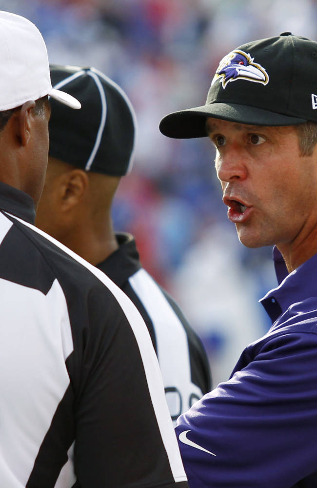 Baltimore Ravens coach John Harbaugh talks with referee Jerome Boger (23) during the second half of an NFL football game against the Buffalo Bills on Sunday, Sept. 29, 2013, in Orchard Park, N.Y. Buffalo won 23-20