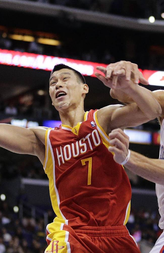 Houston Rockets' Jeremy Lin, left, is defended by Los Angeles Clippers' Blake Griffin during the second half of an NBA basketball game on Monday, Nov. 4, 2013, in Los Angeles. The Clippers won 137-118