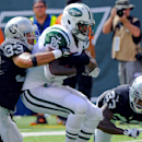 Oakland Raiders' Tyvon Branch (33) tackles New York Jets' Jeff Cumberland (85) as teammate Tarell Brown (23) closes in during the first half of an NFL football game Sunday, Sept. 7, 2014, in East Rutherford, N.J The Associated Press