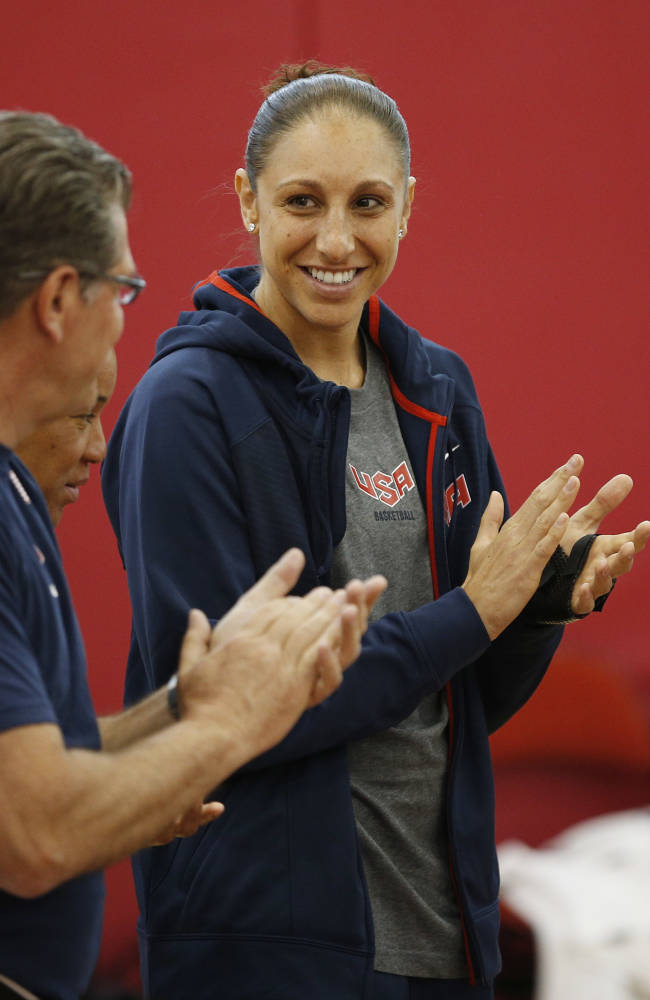 Head coach Geno Auriemma, left, and player Diana Taurasi clap during a USA women's national team minicamp basketball practice Wednesday, May 6, 2015, in Las Vegas. (AP Photo/John Locher)