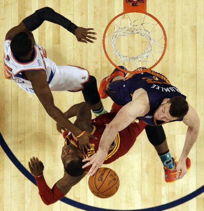 Team Hill's Miles Plumlee of the Phoenix Suns right, vies for a loose ball with Team Hill's Dion Waiters of the Cleveland Cavaliers, center, and Team Webber's Victor Oladipo of the Orlando Magic during the Rising Star NBA All Star Challenge Basketball game, Friday, Feb. 14, 2014, in New Orleans