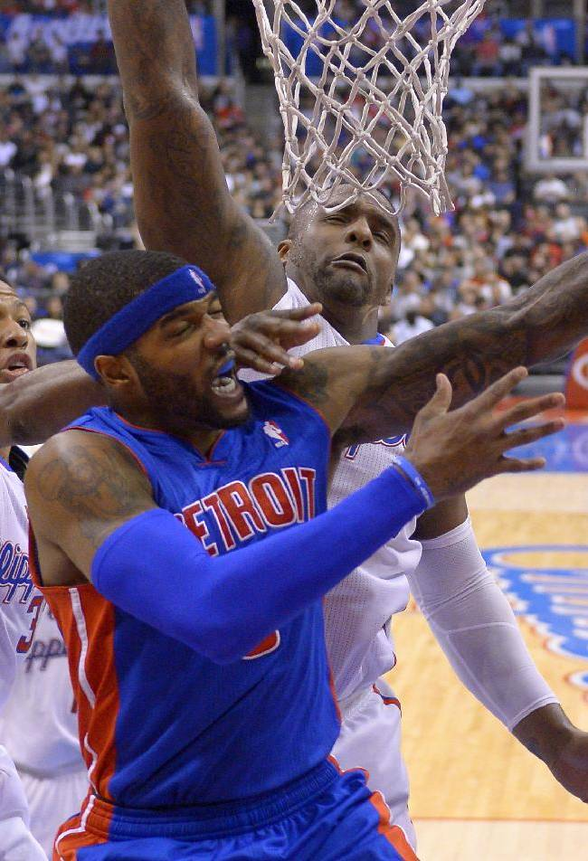 Detroit Pistons forward Josh Smith, center, shoots as Los Angeles Clippers guard Willie Green, left, and forward Glen Davis defend during the first half of an NBA basketball game, Saturday, March 22, 2014, in Los Angeles