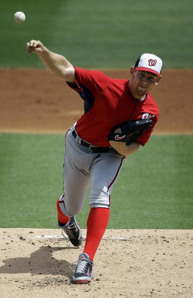 Washington Nationals starting pitcher Stephen Strasburg throws in the first inning of an exhibition spring training baseball game against the Miami Marlins, Saturday, March 15, 2014, in Jupiter, Fla