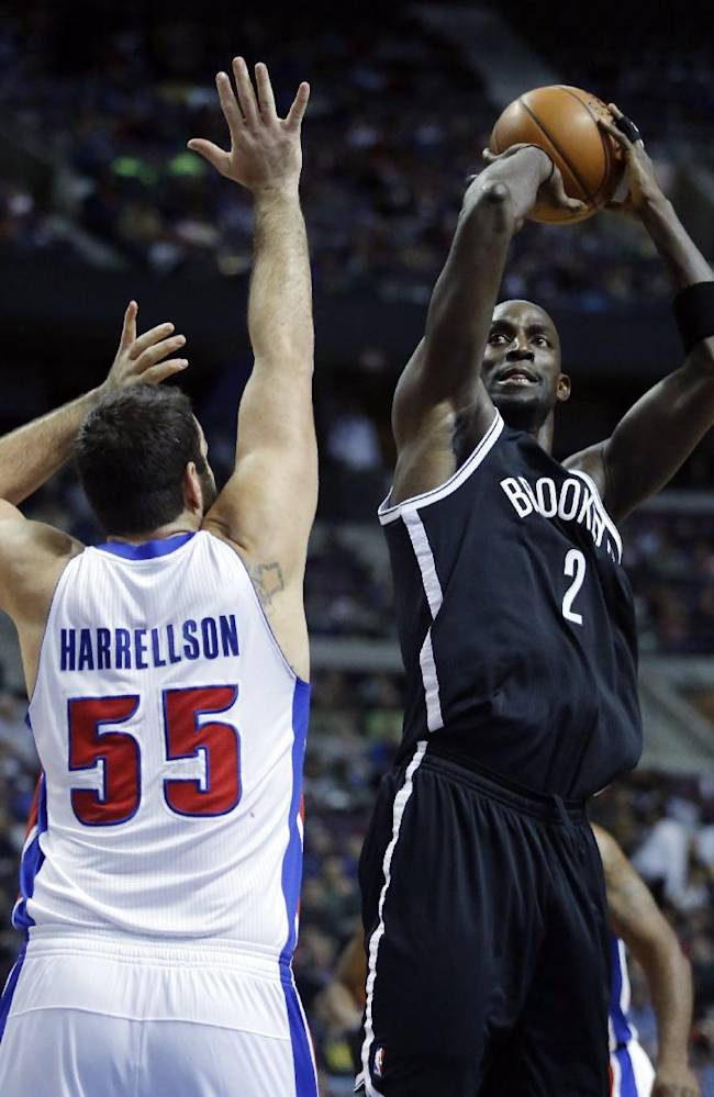 Brooklyn Nets forward Kevin Garnett (2) shoots against Detroit Pistons forward Josh Harrellson (55) during the first half of an NBA basketball game on Friday, Dec. 13, 2013, in Auburn Hills, Mich