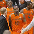 Miami's Sheldon McClellan (10), Davon Reed (5), Deandre Burnett (1) and Tonye Jekiri (23) walk to the bench during a timeout in the second half of an NCAA college basketball game against Pittsburgh, Wednesday, March 4, 2015, in Pittsburgh. Miami won 67-63. (AP Photo/Keith Srakocic)