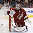 Phoenix Coyotes' Mark Visentin gives up a goal to San Jose Sharks' Joe Pavelski during an NHL hockey game on Saturday, April 12, 2014, in Glendale, Ariz The Associated Press