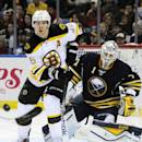 Boston Bruins' David Krejci (46), of the Czech Republic, watches the puck in front of Sabres' Jhonas Enroth (1), of Sweden, during the second period of an NHL hockey game Thursday, Oct., 30, 2014, in Buffalo, N.Y. (AP Photo/Gary Wiepert)