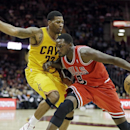 Chicago Bulls' Luol Deng (9), from Sudan, drives the baseline on Cleveland Cavaliers' Alonzo Gee in the third quarter of an NBA basketball game Saturday, Nov. 30, 2013, in Cleveland. Deng led the Bulls with 27 points in a 97-93 loss to the Cavaliers The A