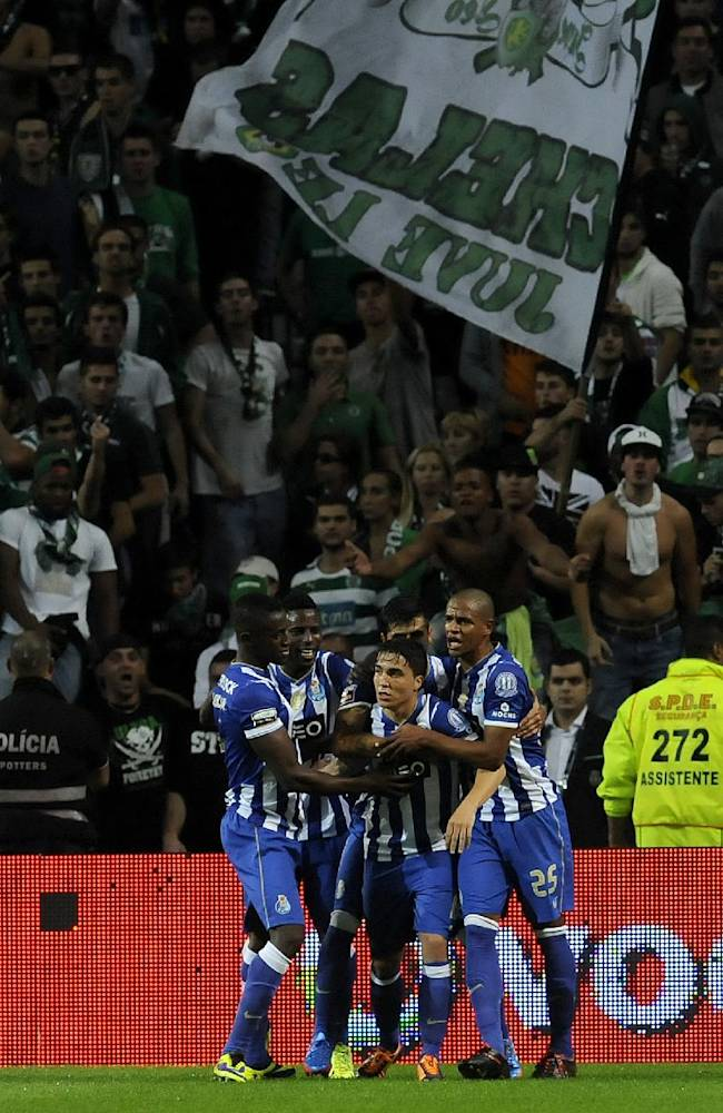 FC Porto's Josue Pesqueira, center, celebrates with teammates after scoring the opening goal against Sporting in a Portuguese League soccer match at the Dragao stadium in Porto, Portugal, Sunday Oct. 27, 2013
