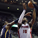 Detroit Pistons center Greg Monroe (10) is fouled by Indiana Pacers center Ian Mahinmi (28) while going to the basket during the second half of an NBA basketball game Tuesday, Nov. 5, 2013, in Auburn Hills, Mich The Associated Press