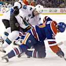 San Jose Sharks' Tomas Hertl (48) and Edmonton Oilers' Boyd Gordon (27) battle for the puck at the face-off circle during the first period of an NHL hockey game, Friday, Nov. 15, 2013 in Edmonton, Alberta The Associated Press