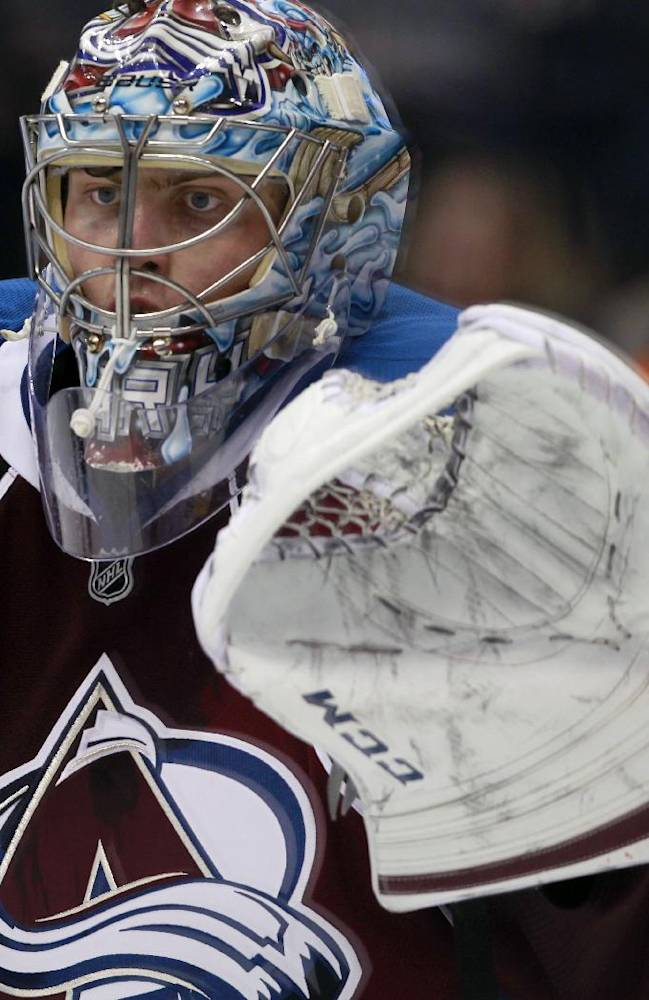 Colorado Avalanche goalie Semyon Varlamov, of Russia, searches for the puck while protecting the goal against the Dallas Stars in the third period of the Avalanche's 6-2 victory in an NHL hockey game in Denver on Monday, Dec. 16, 2013