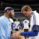 DALLAS, TX - OCTOBER 20: Vince Carter #15 of the Memphis Grizzlies and Dirk Nowitzki #41 of the Dallas Mavericks greet each other before the game on October 20, 2014 at the American Airlines Center in Dallas, Texas. (Photo by Glenn James/NBAE via Getty Images)