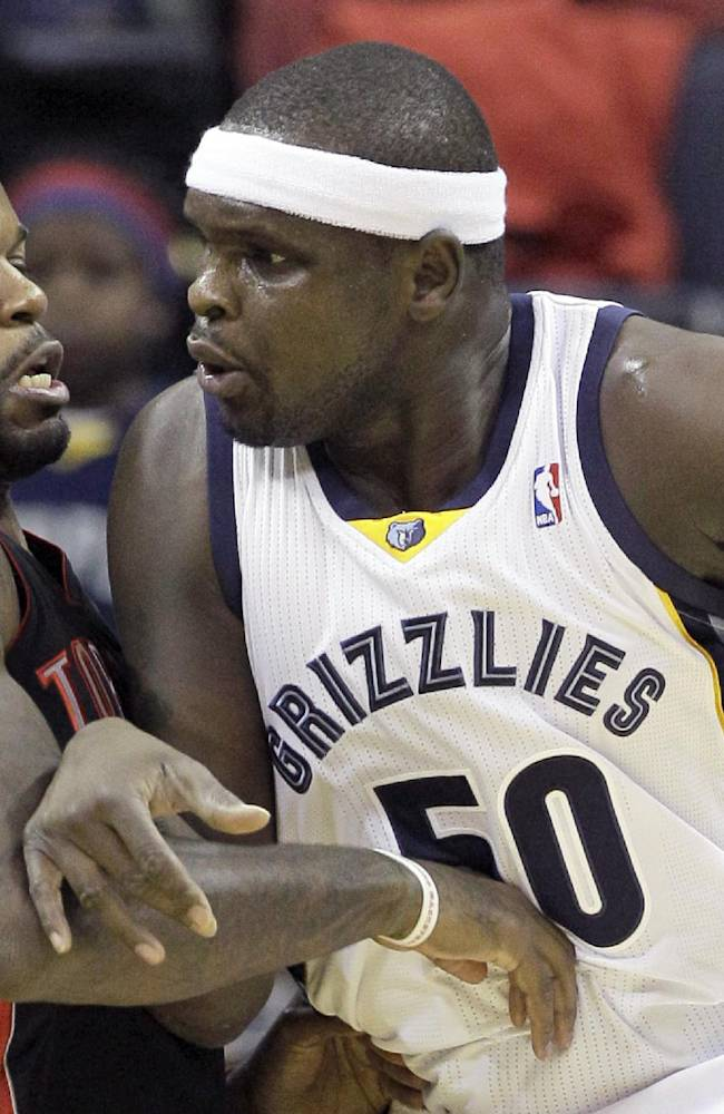 Toronto Raptors' Amir Johnson, right, defends against Memphis Grizzlies' Zach Randolph (50) in the first half of an NBA basketball game in Memphis, Tenn., Wednesday, Nov. 13, 2013