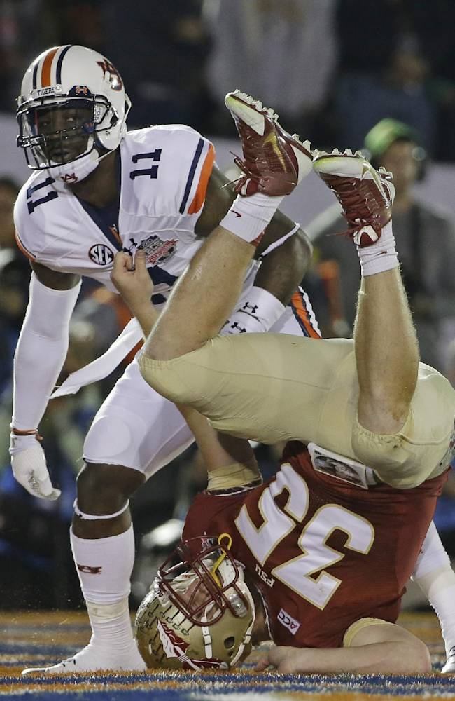 Florida State's Nick O'Leary lands on his head in front of Auburn's Chris Davis (11) after leaping for an incomplete pass during the first half of the NCAA BCS National Championship college football game Monday, Jan. 6, 2014, in Pasadena, Calif