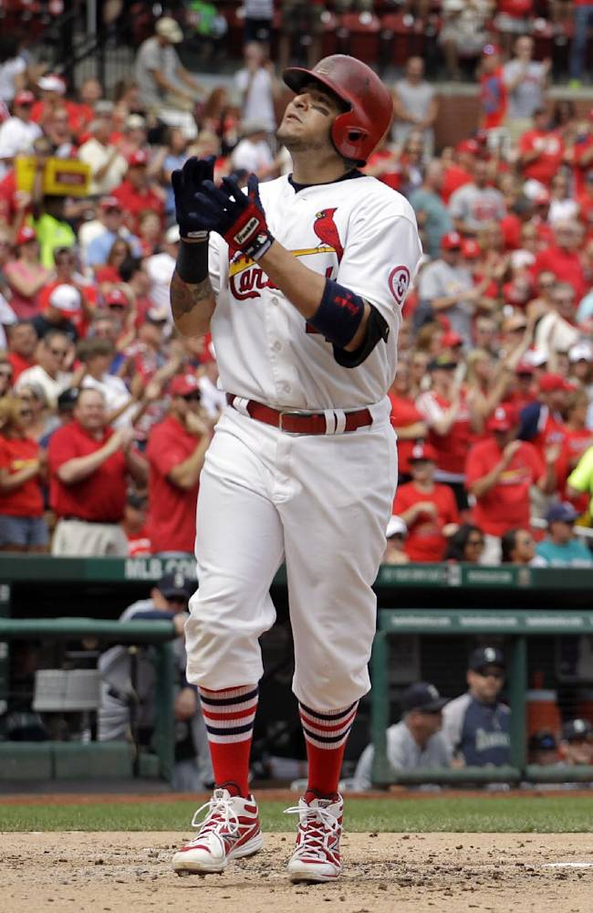 St. Louis Cardinals' Yadier Molina celebrates as he reaches home after hitting a solo home run during the second inning of a baseball game against the Seattle Mariners Sunday, Sept. 15, 2013, in St. Louis