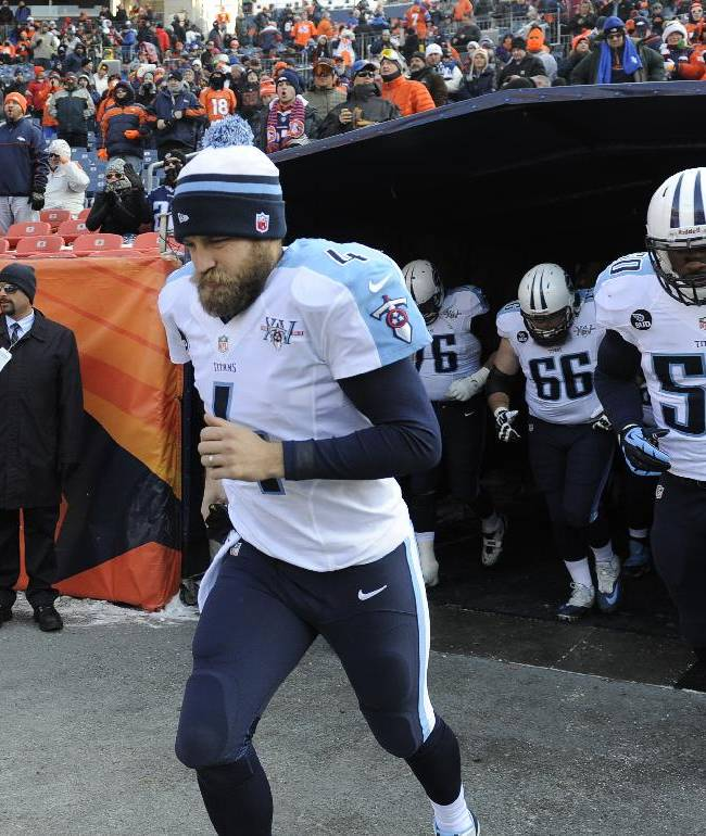 Tennessee Titans quarterback Ryan Fitzpatrick runs into the field before an NFL football game against the Denver Broncos Sunday, Dec. 8, 2013, in Denver