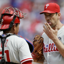 Philadelphia Phillies catcher Carlos Ruiz (51) and starting pitcher Cliff Lee (33) conference during the fifth inning of an opening day baseball game against the Texas Rangers at Globe Life Park, Monday, March 31, 2014, in Arlington, Texas The Associated