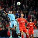 Manchester City's Fernando, left, contests the ball with Liverpool's Rickie Lambert during the English Premier League soccer match between Manchester City and Liverpool at the Etihad Stadium, in Manchester, England, Monday, Aug. 25, 2014
