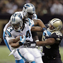 Carolina Panthers running back DeAngelo Williams (34) carries as New Orleans Saints middle linebacker Curtis Lofton (50) tries to tackle in the first half of an NFL football game in New Orleans, Sunday, Dec. 8, 2013 The Associated Press