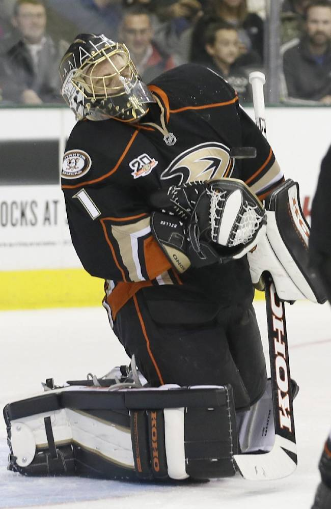 Anaheim Ducks goalie Jonas Hiller (1) stops a shot as the puck bounces off his chest during the first period of an NHL hockey game against the Dallas Stars in Dallas, Tuesday, Nov. 26, 2013