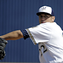 Milwaukee Brewers' Matt Garza throws before an exhibition spring training baseball game against the San Diego Padres, Friday, March 7, 2014, in Phoenix The Associated Press