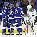 Tampa Bay Lightning right wing Ryan Callahan (24) celebrates with center Steven Stamkos (91) and right wing Nikita Kucherov (86) after scoring past Dallas Stars goalie Jussi Rynnas (40), of Finland, during the third period of an NHL preseason hockey game