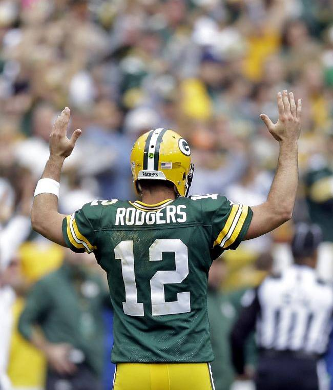 Green Bay Packers' Aaron Rodgers reacts after a 32-yard touchdown run by James Starks during the second half of an NFL football game against the Washington Redskins Sunday, Sept. 15, 2013, in Green Bay, Wis
