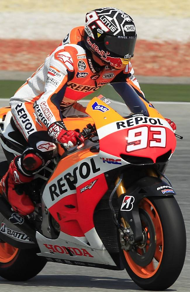 MotoGP rider Marc Marquez of Spain steers his Honda during a pre-season test at Sepang International Circuit in Sepang, Malaysia, Tuesday, Feb. 4, 2014