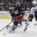 Columbus Blue Jackets' Ryan Johansen, left, carries the puck past Winnipeg Jets' Dustin Byfuglien during the second period of an NHL hockey game Tuesday, Nov. 25, 2014, in Columbus, Ohio The Associated Press