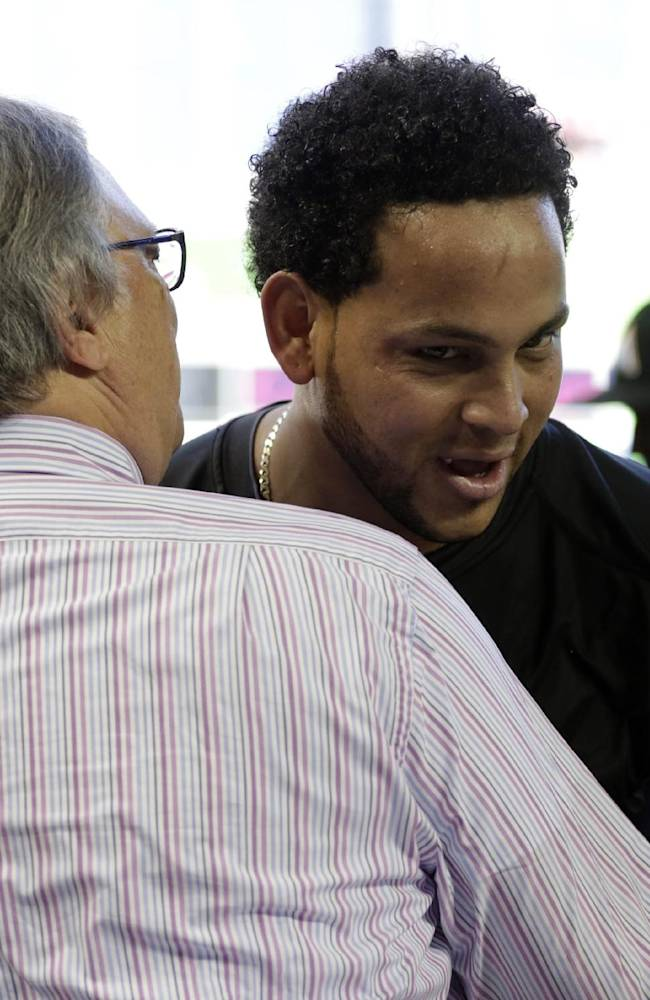 Miami Marlins' Henderson Alvarez, right, is congratulated by Marlins owner Jeffrey Loria after pitching a no-hitter against the Detroit Tigers in an interleague baseball game on Sunday, Sept. 29, 2013, in Miami. The Marlins won 1-0