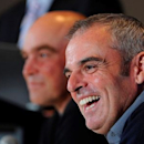 Paul McGinley of Ireland laughs during a news conference after being named the European Ryder Cup captain at the St. Regis in Saadiyat Islands in Abu Dhabi January 15, 2013. REUTERS/Ben Job