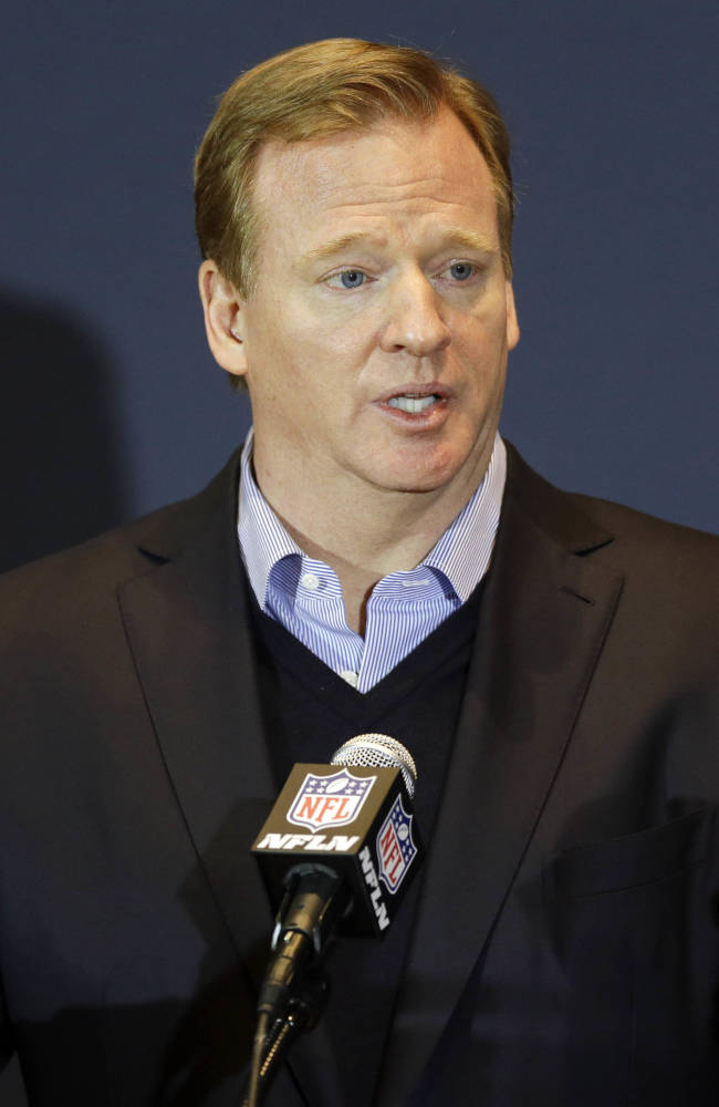 NFL Commissioner Roger Goodell answers questions during a news conference at the NFL football annual meeting in Orlando, Fla., Wednesday, March 26, 2014