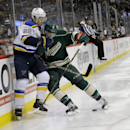 Minnesota Wild center Charlie Coyle, right, pins St. Louis Blues defenseman Kevin Shattenkirk (22) against the boards as they chase the puck during the second period of an NHL hockey game in St. Paul, Minn., Saturday, Nov. 29, 2014 The Associated Press