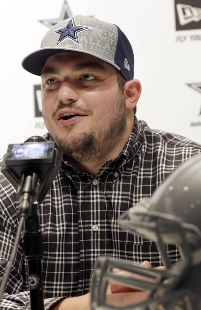 Dallas Cowboys Draft choice Zach Martin speaks to reporters at Valley Ranch in Irving, Texas, Saturday, May 10, 2014.  Martin will forever be known as the player the Cowboys drafted instead of Johnny Manziel and the Notre Dame offensive tackle is fine with it. Cowboys took Martin with the 16th pick in the first round of the NFL draft